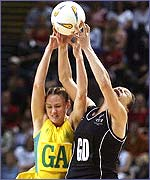 Australia and New Zealand netballers fight for the ball