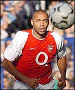 Thierry Henry chases a bouncing ball