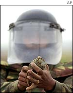 Indian Army soldier defuses a land mine in Punjab