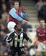 New West ham signing Lee Bowyer climbs above Olivier Bernard at Upton Park