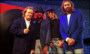 Bruno Brookes with the Bee Gees, Maurice, Robin and Barry Gibb after performing the song How Do I Fall In Love Part 1 on Top of the Pops  in 1994