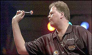 Barneveld lines up a dart as he nears victory