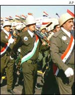Iraqi army volunteers march during a military parade in Basra, southern Iraq.