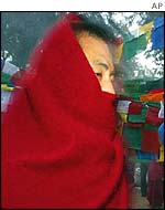 A Buddhist monk wraps up warm in Bodh Gaya