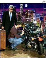 Tom Cruise signs Jay Leno's Harley-Davidson for an e-bay auction