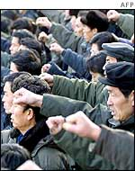 North Koreans protest in support of leader Kim Jong-il