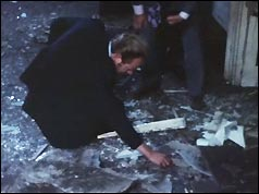 Police examine the damage after the blast