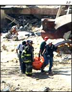 Rescuers remove a body from Ground Zero