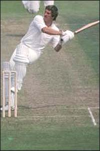 Ian Botham plays a pull shot towards the boundary