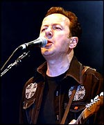Strummer playing live with The Mescaleros