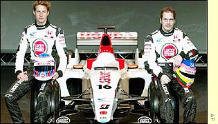 Jenson Button and Jaques Villeneuve pose with the new BAR 005