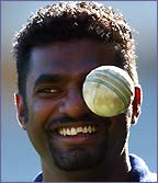 Muttiah Muralitharan looks like he has a white ball for an eye as he tosses the ball in practise