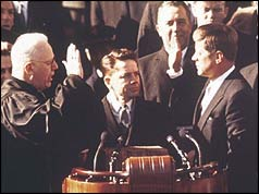 John F Kennedy (r) taking the oath of allegiance
