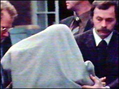 Gunman Barry Williams under a grey blanket, in custody