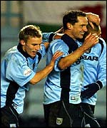 Dean Holdsworth celebrates his goal against Cardiff