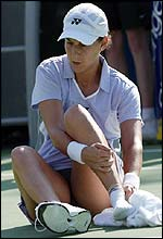 Monica Seles receives treatment for an ankle injury in the first set