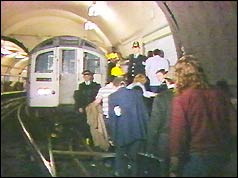 Passengers are led to safety through tube tunnel
