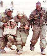 US Marines help an injured colleague in 1991