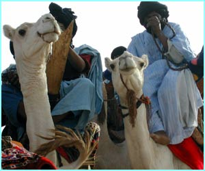 Nomads travel about on camels and live in tents