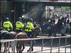 Mounted police confront hooligans