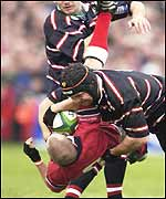 Gloucester's Peter Buxton produced a big tackle on Peter Stringer