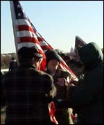 A smaller group of pro-war demonstrators unfurled the flag
