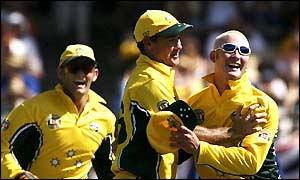 Michael Clarke celebrates with team-mates