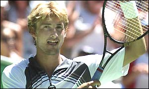 Juan Carlos Ferrero acknowledges the crowd after his easy victory over Mario Ancic