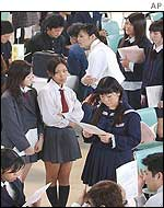 School graduates and students at a job fair in Ginowan, Okinawa