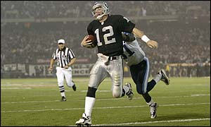 Quarterback Rich Gannon of the Oakland Raiders stretches into the end zone for a touchdown