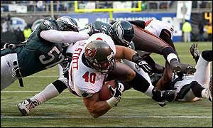 Mike Alstott of the Tampa Bay Buccaneers dives over the goal line for a touchdown