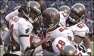 Tampa Bay Buccaneers receiver Keyshawn Johnson is swarmed by team-mates