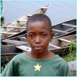 This is 11-year-old Francis from Ghana, and he has to work on a lake to earn money