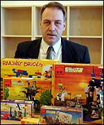Lego lawyer Henrik Jacobsen doesn't have any books for his bookshelves.  But he does have  		toys - weee!