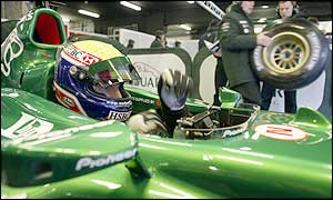 Mark Webber sits in the cockpit of the Jaguar Formula One car