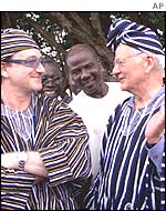 Bono (left) with Paul O'Neill in Ghana in May 2002