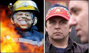 A striker in Blair mask, and FBU leader on the picket line