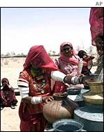 Women collect water at a well in Rajasthan