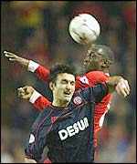 Liverpool striker Emile Heskey and Sheffield United's Shaun Murphy