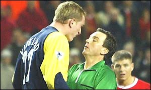 Liverpool keeper Chris Kirkland is lucky not to be sent off for a foul on Wayne Allison