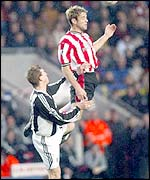 James Beattie climbs above Newcastle defender Stephen Caldwell