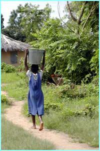 Here's Judith carrying water home to her family