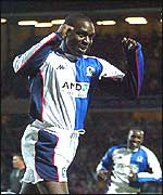 Andy Cole celebrates his goal