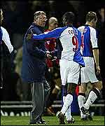 Andy Cole congratulates Sir Alex Ferguson