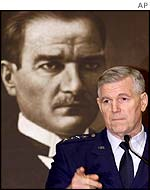 US Chairman of the Joint Chiefs, General Myers, in front of a portrait of Kemal Ataturk