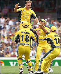 Australia's Andy Bichel celebrates after taking the wicket of England batsman Michael Vaughan