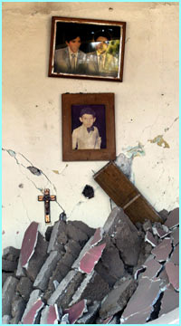 Pictures still hang on a wrecked wall. Colima is about 760 km (470 miles) west of Mexico City...