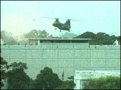 An American helicopter lands on the roof of the US Embassy, Saigon, during the evacuation