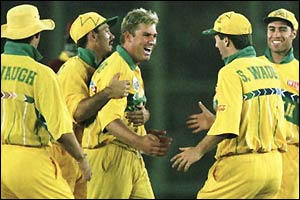 Warne celebrates after taking career-best one-day figures