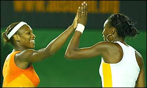 Serena and Venus Williams celebrate winning the second set to level the match